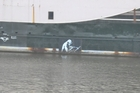 Bristol authorities painted over the first Grim Reaper on a nightclub ship moored in the city's docks. Photo / Catherine Field
