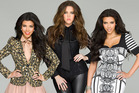 Kourtney Kardashian, left, with her sisters Khloe and Kim.