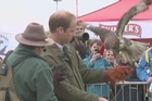Britain's Prince William took part in gundog and falconry displays and met with farmers at the Anglesey Show in Wales, his first public engagement since the birth of his son.