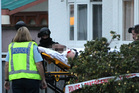 A critically injured man is stretchered away after being accidentally shot by police. Photo / Hawkes Bay Today