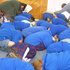 Children and staff drop, cover and hold as they've been taught at St Mary's School, Carterton. Photo / Gerald Ford