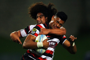 Sam Vaka of Counties Manukau is tackled by Tua Saseve of North Harbour during the round two ITM Cup match. Photo / Getty Images