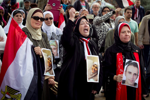 Naylaa El-Hakim, Nawal El-Beih and Nahla Yazal from the Auckland Egyption community hold photos of people who have been killed in the protests in Egypt. Photo / Chris Gorman