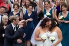 THE KISS: The happy couples kiss in front of their friends and family after the ceremony.190813SP11