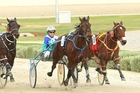 Ideal Scott, centre, holds on to win the Breeders Crown at Melton yesterday. Photo / Stuart McCormick