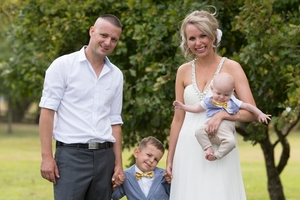 Justin Crockett, who has a brain tumour, with wife Jane and sons Chase and baby Koen. Photo / Dean Carruthers