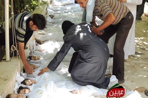 A Syrian woman mourns over the dead bodies of children after the alleged poison gas attack. Photo/ AP