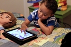 "Educational researchers say preschoolers are obsessed with iPads, or a ""rattle on steroids"". Photo / AP"