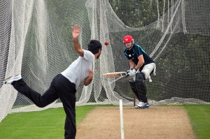 Ronnie Hira got plenty of turn out of the Bay Oval grass nets against fellow Black Cap Peter Fulton. Photo / Andrew Warner