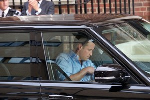 Prince William drive his wife and new baby home from hospital.Photo / AFP