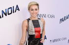 Miley Cyrus wants her long locks back. Photo / AP