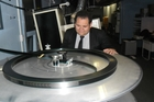 Anthony Mitchell keeps an eye on the feeder unit which is sending the movie 'Man of Steel' to a nearby 35mm projector.