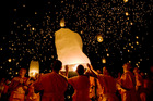 Buddhist monks releasing lanterns during the Yi Peng Sansai Kathina ceremony. Photo / Lonely Planet Images