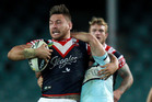 Jared Waerea-Hargreaves of the Roosters is tackled. Photo / Getty Images