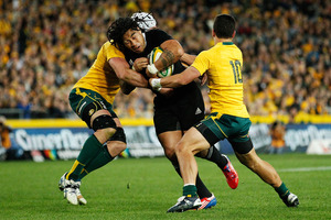 Ma'a Nonu of the All Blacks is tackled by Matt Toomua and Ben Mowen of the Wallabies. Photo / Getty Images