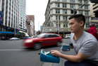 Auckland University environmental sciences student Shanon Lim tests the air quality, measuring fine air particles and carbon-monoxide levels. Photo / Brett Phibbs
