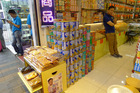 Towers of Karicare infant formula at a shop entrance in Kowloon's Tsim Sha Tsui district. Photo / Christopher Adams