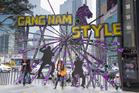 Gangnam Style has overtaken street corners in Seoul; and below, pop star Psy. Photo / AP