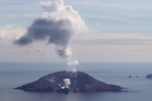 White Island, off the Bay of Plenty coast, eruptes, leaving a plume of smoke hanging in the sky