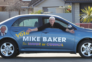 "Mike Baker has covered some words on his campaign car. ""It makes it hard for wannabes,'' he says."