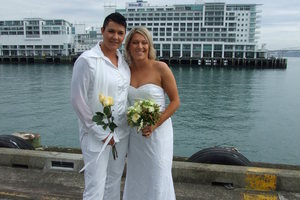 Tash Vitali, left, and Melissa Ray on their wedding day. Melissa's dress is for sale in an online charity auction.