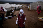 Abdullah Ahmed, 10, suffered burns in a Syrian government airstrike and fled his home with his family. Photo / Getty Images