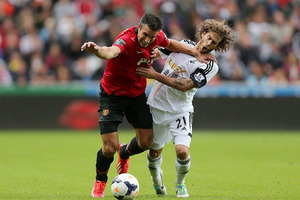 Manchester United's Robin van Persie, left, and Swansea City's Jose Alberto Canas battle for the ball during the English Premier League soccer match at the Liberty Stadium. Photo / AP