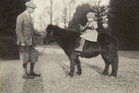 Previously unpublished family photograph issued by the Royal Collection of Britain's Queen Elizabeth II with the Duke of York on Shetland pony, Peggy in 1930.Photo / AP