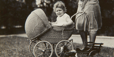 Previously unpublished family photograph issued by the Royal Collection of Britain's Queen Elizabeth II sitting in a wicker pram in 1928.Photo / AP