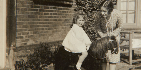 Previously unpublished family photograph issued by the Royal Collection of Britain's Queen Elizabeth II with her mother Elizabeth Bowes-Lyon and a toy horse in front of Naseby.Photo / AP
