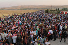 Syrian refugees cross the border to Iraq at Peshkhabour border point at Dahuk.  Photo / AP