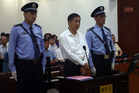 Bo Xilai denied receiving a bribe of $229,000 from a businessman when questioned in court. Photo / AP
