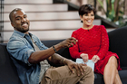 Kanye West, left, with host Kris Jenner during a taping of her talk show 'Kris' in Culver City, California. Photo / AP