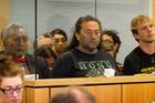 The 'Urewera 4' - Tama Iti, Te Rangikaiwhira, Urs Signer and Emily Felicity Bailey - in the High Court in Auckland.