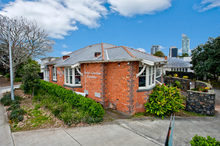 Exterior street level view of Grace Abbott House, for sale at 415 Lake Rd on the corner of Lake Rd and Esmonde Rd, Takapuna.