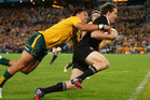 Ben Smith of the All Blacks beats Christian Lealiifano of the Wallabies to score a try during The Rugby Championship Bledisloe Cup match. Photo / Getty Images.