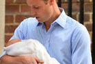 Prince William with his new son, George.Photo / AFP