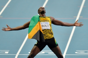 Usain Bolt wants to defend his Olympic titles in Rio. Photo / AP