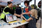 SAFETY DRIVE: Sandra Heihei (left), ACC injury-prevention consultant, Murray Hodson, police inspector, and Gillian Archer, Northland Regional Council's Road Safe Northland co-ordinator, deliver road-safety messages at Cameron St Mall yesterday. PHOTO/ JOHN STONE