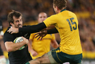 Conrad Smith breaks through the tackle of Jesse Mogg of the Wallabies. Photo / Getty Images