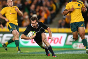 Conrad Smith crosses over to score for the All Blacks. Photo / Getty Images