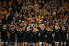 The All Blacks sing the national anthem before Saturday's test in Sydney, the first played under the new rule designed to cut scrum injuries. Photo / Getty Images