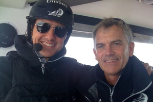 Multi-hull design guru Pete Melvin (right) with Tom Cruise on the AC72 in San Francisco Bay.