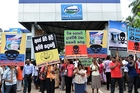 Activists demonstrate in front of the Fonterra dairy factory in the Colombo suburb of Biyagama. Photo / AFP