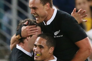Ben Smith (above left) celebrates a try with Israel Dagg (above right) and Aaron Smith. Photo / Getty Images