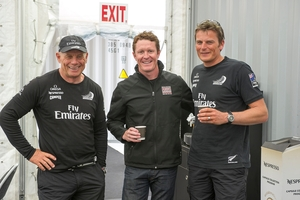 Grant Dalton (left) Scott Dixon and Dean Barker (right) discuss speed around a coffee at Team NZ's base in San Francisco yesterday. Photo / Chris Cameron