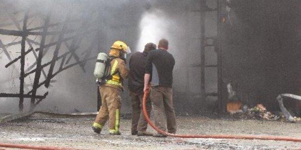 Firefighters battle the blaze at Maungawera Lodge. Photo / Catherine Pattison