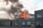 A huge fire blazes at the Racetech car seat manufacturing building in Petone.