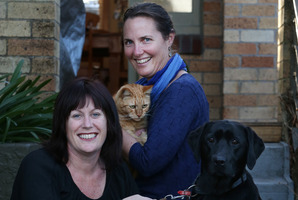 Kim Edwards with her cat Rory and Michelle Whitmore and her dog Maci.Photo / Joel Ford