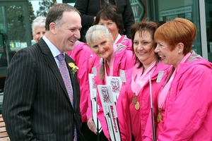 ENGAGING: Prime Minister John Key speaks with members of breast cancer survivor group Boobops.300813AW03BOP